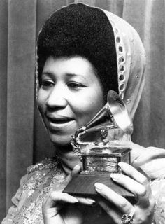 Aretha Franklin with her Grammy.  10 Reasons Why Aretha Franklin is the Queen of Soul