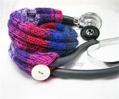 This striped Stethoscope cozy is knitted with a self striping sockyarn in different purples and blues. It is hand knitted in the round, so no seams can snag on the bell when you pull it up. The bottom of the knitted tube is reinforced with elastic thread. The top is closed by a loop over a pearly colored button  measurements about: whole cozy: 17inches / 43 cm  care: wash in the cold gentle cycle in the machine then pull back in form air dry  You can buy fabric stethoscope covers in the…