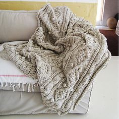The size of this throw is approx 1.85m x 1.4m (72 x 55 inches), but you could make it longer if you'd like, by repeating more patterns. It is knitted with 2kg wool blend using multiple strands together.