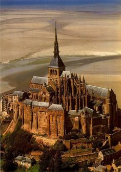 "Le Mont Saint Michel, France. Victor Hugo said that Mont Saint Michel ""…is to the ocean what the Cheops Pyramid is to the desert… a masterpiece of nature and art."""