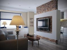 Perete despartitor placat cu caramida decorativa in living open space cu bucataria