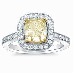 Yellow diamond halo ring.  Absolutely stunning.