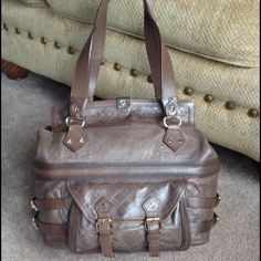🔥1 HR SALE🔥 L.A.M.B. Kensington Halloway Satchel Gorgeous and SUPER RARE L.A.M.B. Kensington Halloway Satchel in Smoke❤️ Absolutely LOVE this ALL LEATHER bag but it just sits as I have too many!! Excellent condition, leather is super soft and the details on this bag are endless! Please view all pics and will make an additional listing for more pics! All questions welcome😊 Cheaper thru 🅿️🅿️ $125 (with shipping thru Posh $3) Just let me know😘 L.A.M.B. Bags Satchels