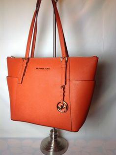 e1e9a0c416b8 orange michael kors purse