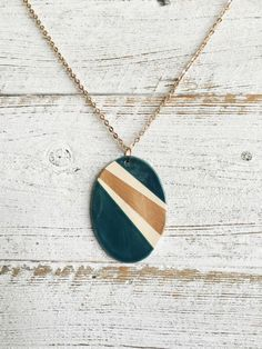 Ceramic Oval Pendant, Dark Teal, Rose Gold, Modern, Unique Gift, Minimal, Fashion, Ceramics, Unique Jewelry, Ceramic Jewelry by southerngracie on Etsy https://www.etsy.com/listing/473934467/ceramic-oval-pendant-dark-teal-rose-gold
