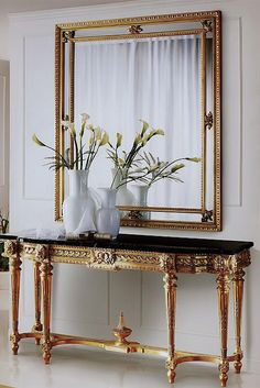 STUNNING ENTRYWAY | Gold and black amazing console | bocadolobo.com/ #modernentryway #entrywayideas