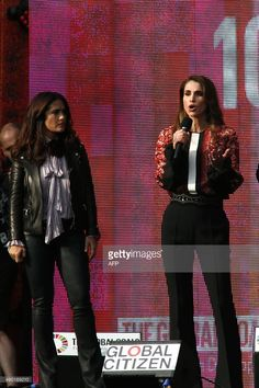 Queen Rania Al Abdullah of the Hashemite Kingdom of Jordan (R) and Chime for change co-founder Salma Hayek Pinault attend the fourth annual Global Citizen Festival in Central Park Manhattan on September 26, 2015 in New York. The Festival is part of the Global Poverty Project, a UN-backed campaign to end extreme poverty by 2030. Headliners include Beyonce, Pearl Jam, Coldplay and Ed Sheeran. AFP PHOTO/KENA BETANCUR