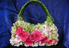 The Daily Blossom / AP   This photo shows a pink rose multi-floral handbag by The Daily Blossom. A dainty, special-occasion handbag covered with fresh flowers could be an elegant outfit¿s perfect accessory - albeit a short-lived one.