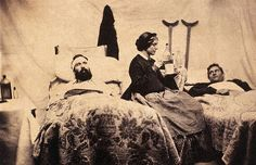 1861-1865, Nashville, Tennessee, Confederate States of America --- Two wounded Federal soldiers are cared for by Anne Bell, a nurse during the American Civil War