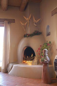 Chimayo house rental - Kiva fireplace warms the mid winter