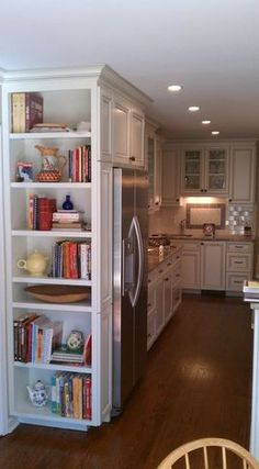 Book case in kitchen for cookbook...look at new house to see if there is a section that can be converted into this.