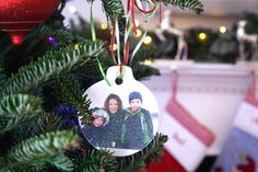 Easy Photo Transfer Christmas Ornaments. Make cute, family ornaments for your tree using just a few, simple craft supplies.