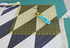 found on Craftsy.com - how to bind quilts with a six-step method - here Trim the corners
