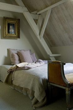 Attic bedroom decorated in neutral tones