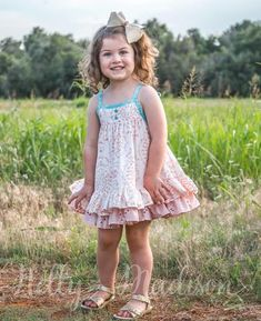 #nellymadisonclothingco #madeinamerica #hannah #loveletters #floral #rufflesandbow #sisterset #familyphotography #poetry #pinksandblues     High volume ruffled hem dress with adjustable shoulder ties Pink florals with blue accents Dress...