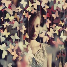 Oprisco- I really like the color and feeling of this photo.  The butterflies around her look really pretty and kind of hide her in a way.  I also like how some of the butterflies up close are blurry but the ones around her are clear,