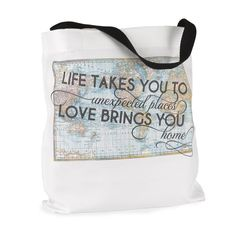 """Travel to unexpected places with this destination wedding party inspired tote bag. White, 100% polyester tote bag with black handles. Features map design with """""""