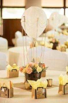centro de mesa para bautizo con flores de niña