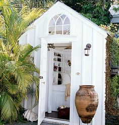 Charming white shed with a Coastal touch. See other ideas on the Our Boat House blog page.