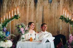 Wedding loveseat with barn door back drop.  Photo by Alexandra Elise Photography.   . #barnwedding #candles #countrywedding #polebarn #married #wedding #laugh #loveseat #loveseatwedding #elegant #country #vintage