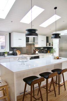 Ikea kitchen | midcentury modern kitchen | white kitchen | vaulted ceiling | waterfall island | granite countertop | ocean foam granite | ikea kitchen cabinets