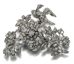 GARNET AND DIAMOND BROOCH, 18TH CENTURY, Designed as a bird resting on a branch in full bloom, set throughout with lasqué-cut and rose diamonds, the bird with a garnet eye, one small diamond deficient, later brooch pin.