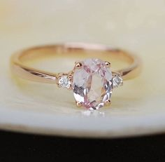 Peach sapphire engagement ring. Promise ring. Oval engagement ring. 3 stone ring. Rose gold engagement ring. Gemstone ring by Eidelprecious by EidelMini on Etsy https://www.etsy.com/listing/524160024/peach-sapphire-engagement-ring-promise