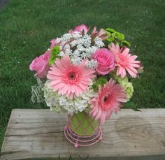 PINK PARFAIT:  A mix of flowers in Pinks, Greens and Whites is arranged in this decorative caged tin. #MatlackFlorist