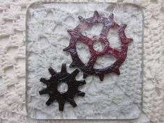 Handmade fused glass coaster - copper cogs on hint of purple tint £8.00