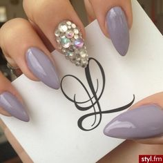 Personally don't like the shape of stiletto nails but I love the colour and gems on these!