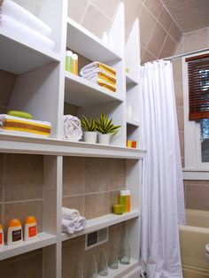 Small Bathrooms - open shelving makes rooms seem larger because you can see to the wall