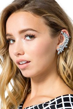 Make a diva statement in this killer jeweled ear cuff! Featuring a curved wing-shaped body and glittering clear rhinestones. Polished metal body. Single stud earring included. $5.50