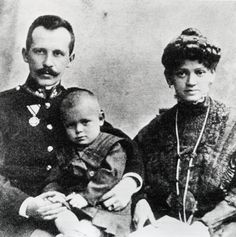 Karol Wojtyla as a young child with his parents.