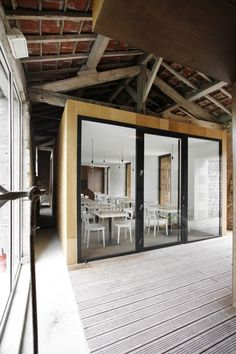 Barn renovation, Charroux, France by Comac. Rustic + modern #architecture (N.B.: article texts reads like machine translation.)