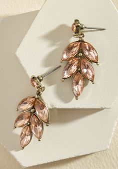 Editor in Leaf Earrings in Blush. Greet guests at the launch party with a sparkling smile and these glistening earrings!  #modcloth
