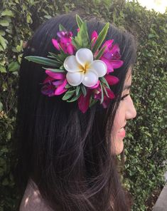 """Tropical Hawaiian Flowers Hair Clip by HULA FLOWERS *************Sharing And Made with Aloha************* This Beautiful Flower Hair Clip is composed of: Silk Orchids & Silk Leaves. Foam Plumeria size 2.5"""" All man-made fiber materials. Built on a silver metal hair clip 3 Inches long."""