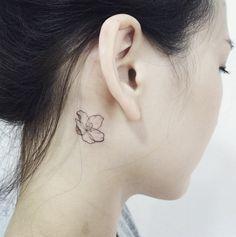 Flower tattoo.   Tattoo artist: doy