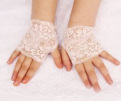 Hey, I found this really awesome Etsy listing at http://www.etsy.com/listing/169330164/baby-fingerless-gloves-in-ivory-lace