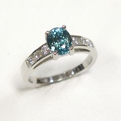 This is such a beautiful blue zircon ring. I like the idea of having something conflict-free and not a diamond.