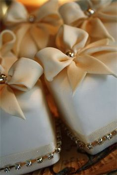 Bows & Bling Miniature Cakes : Miniature cakes with sugar bows, silver balls, ribbons and diamante banding