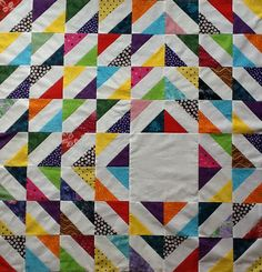 """Multi Colored Signature Block Quilt  Unfinished size is 44"""" by 44"""".  Could add a border.  The white rectangle areas are for signatures and well wishes.  The large white offcenter square can be for an applique of flowers, birds, hearts... or a black and white photo of the recipient (ie. bride and groom, retiree, teacher... ).    I can create a Keepsake Quilt for you.  More pictures of quilts at DebbieLangeQuilting.blogspot.com  Email to DebbieLangeQuilting@gmail.com    Facebook at Debbie Lange..."""