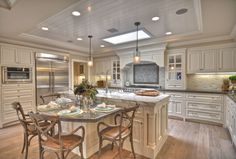 Traditional Kitchen with Undermount sink, Built In Refrigerator, electric cooktop, Crown molding, built-in microwave, Galley