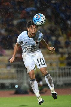 Shinji Kagawa #10 of Japan heads during the 2018 FIFA World Cup Qualifier…
