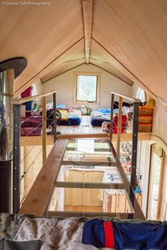 Here is a simple, creative solution if you need more loft space. What about two lofts with a cool mini-skywalk in between? - 7 Tiny House Lofts I Would Totally Sleep In