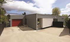 Jennian Homes is New Zealand's most awarded home builder. Discover our great range of plans, house designs and house and land packages. Steel Roofing, Property Design, Home Builders, Building Design, Home Goods, House Plans, Garage Doors, New Homes, Container