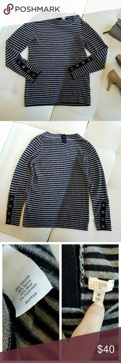 🚨SALE🚨 {J. Crew} Cashmere Blend Sweater J. Crew classic striped sweater in navy blue and gray. Button details on the sleeves, and back collar. Slightly longer length makes this perfectly comfy with jeans, leggings, or a mini, for fun. Mix between crew and faux turtleneck. Supersoft.  5% cashmere blended with other cozy fabrics to create a sweater that feels like a cloud! EUC. Has been worn a lot, but no flaws that I see. Some fuzzies here 'n there due to the material. Ask all Qs before…