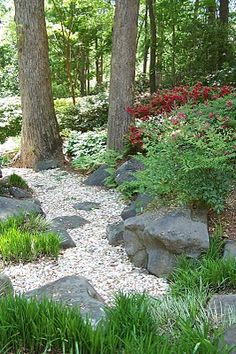 Dry creek bed - boulders in color/texture contrast to small stones.  Love the red in the plantings.