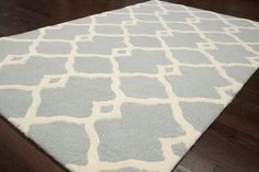 This comes in sand too...but this site has a large variety of rugs...Tuscan Nadra Trellis Lt Grey Rug | Contemporary Rugs