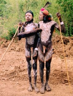 Mursi tribe in southern Ethiopia {follow link for beautiful pics}