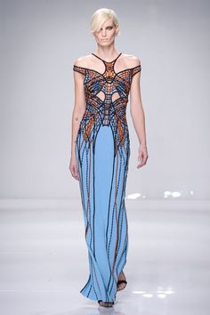 """Atelier Versace kicked off the shows in Paris with a collection that was deemed """"sporty couture,"""" featuring cutaways and athletic-inspired colorblocked buckles. This braided bodice over a more traditional column gown proves that these two worlds actually can come together.  #refinery29 http://www.refinery29.com/2016/01/102180/prettiest-dresses-paris-haute-couture-spring-2016-shows#slide-5"""